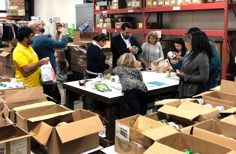 Aventure Staff Volunteers to Help Families