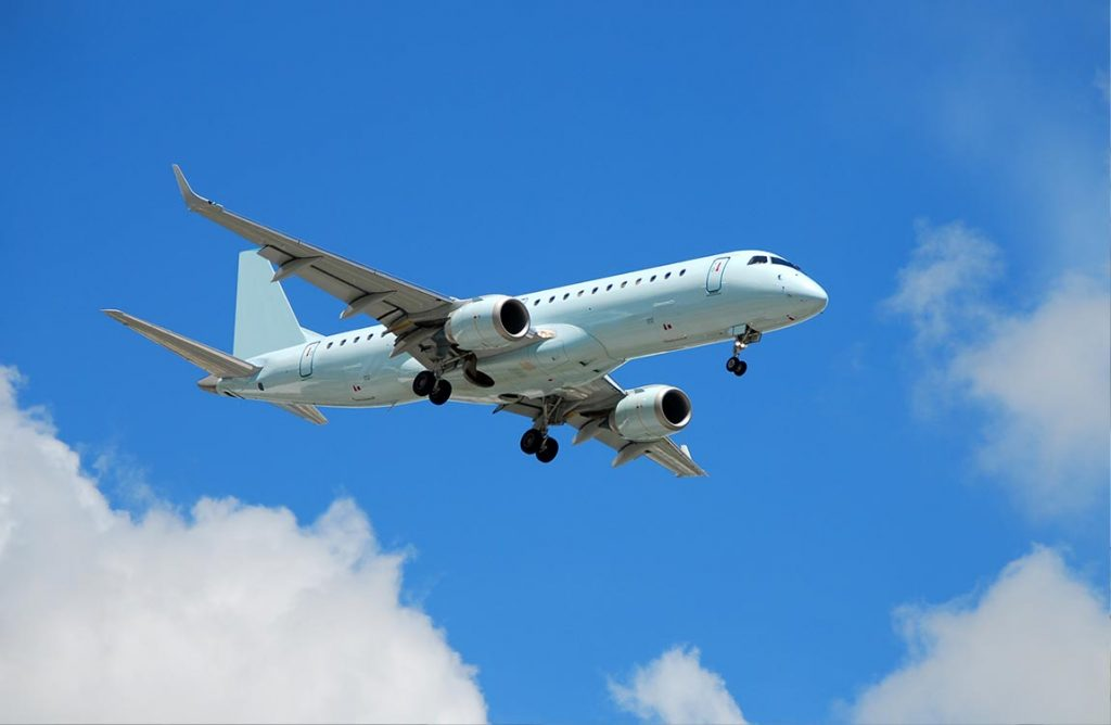 Embraer 190 jet airplane in flight