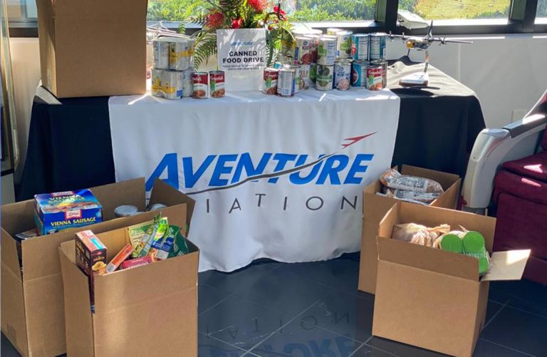Boxes of canned food donations inside Aventure Aviation's Atlanta headquarters