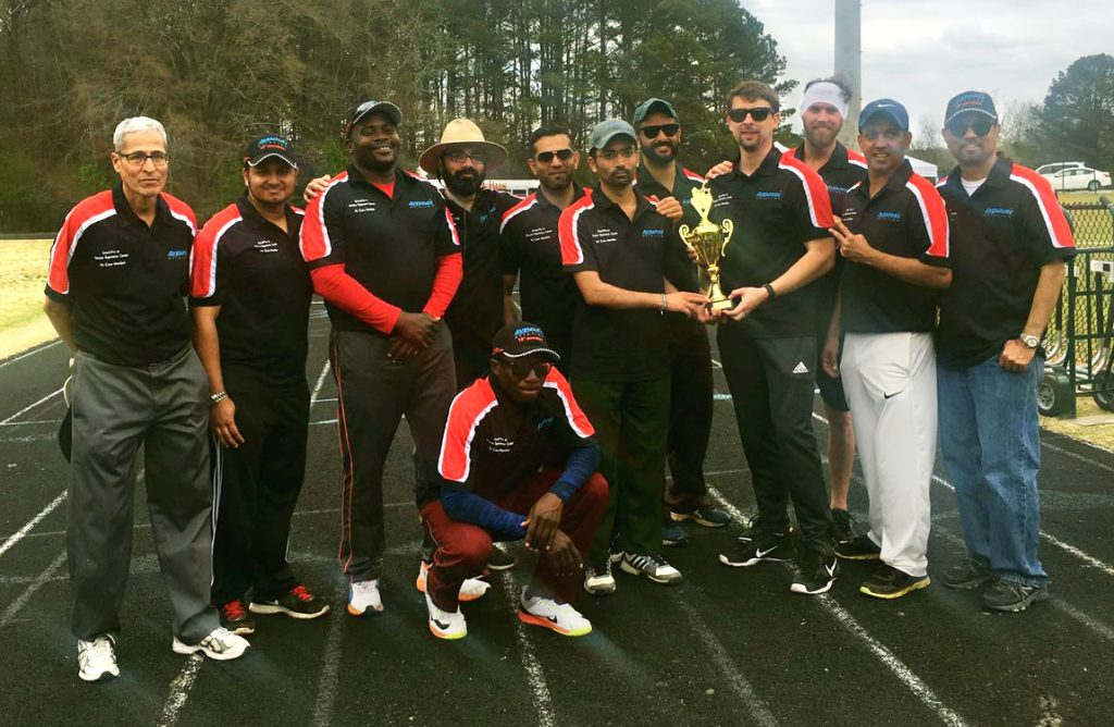 The Aventure Aviation Flyers cricket team with their newly won trophy.