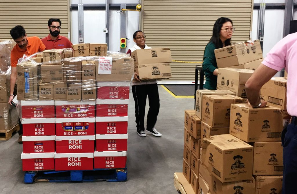 Aventure Aviation team members volunteer at the Midwest Food Bank's Georgia division in Peachtree City