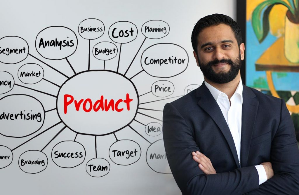 Aventure Aviation Sales Director Ebrahim Zakaria in front of a white board with project management notes