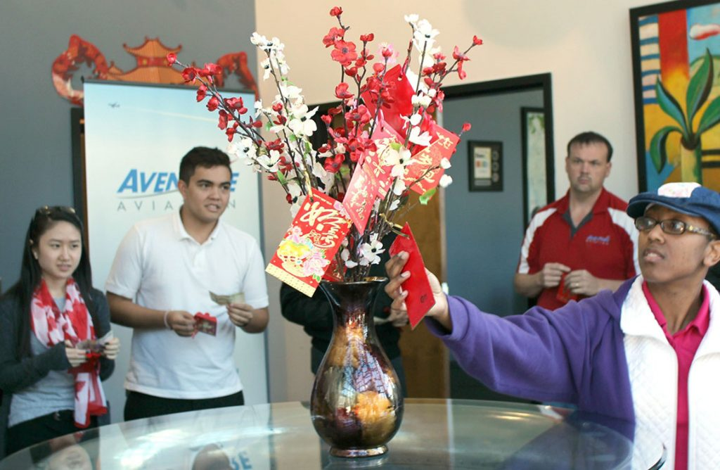 Aventure staff celebrate the Year of the Rooster 2017 at their Atlanta headquarters