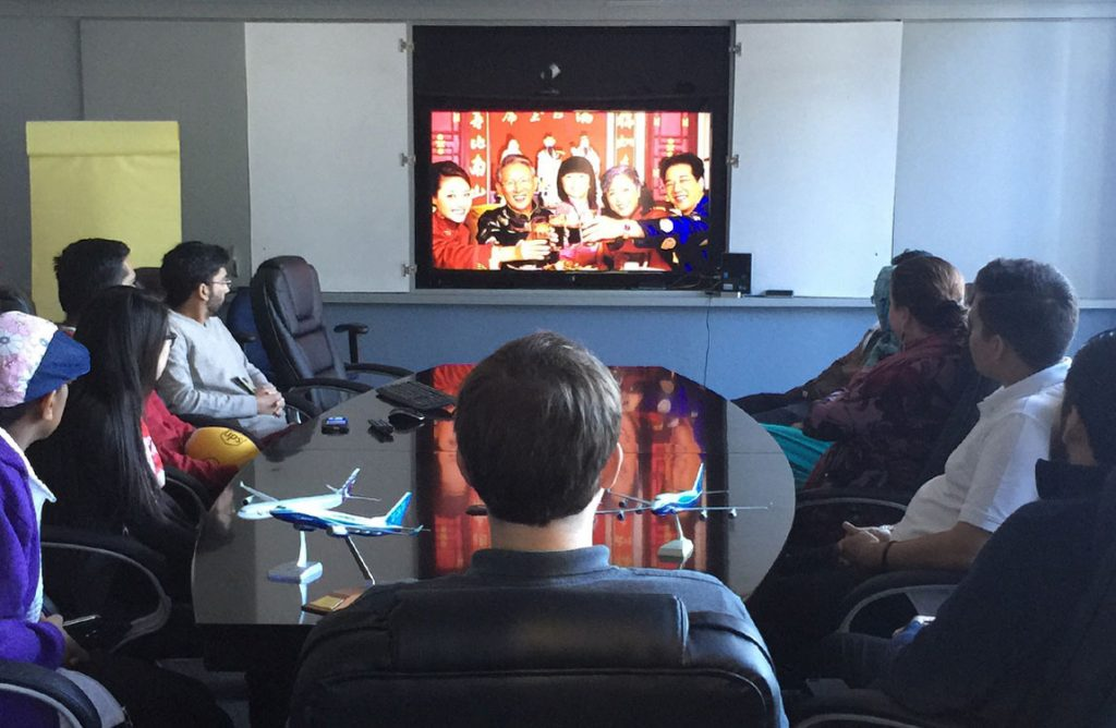 Aventure Aviation staff in Atlanta video chat with their coleagues in China for the Year of the Rooster 2017