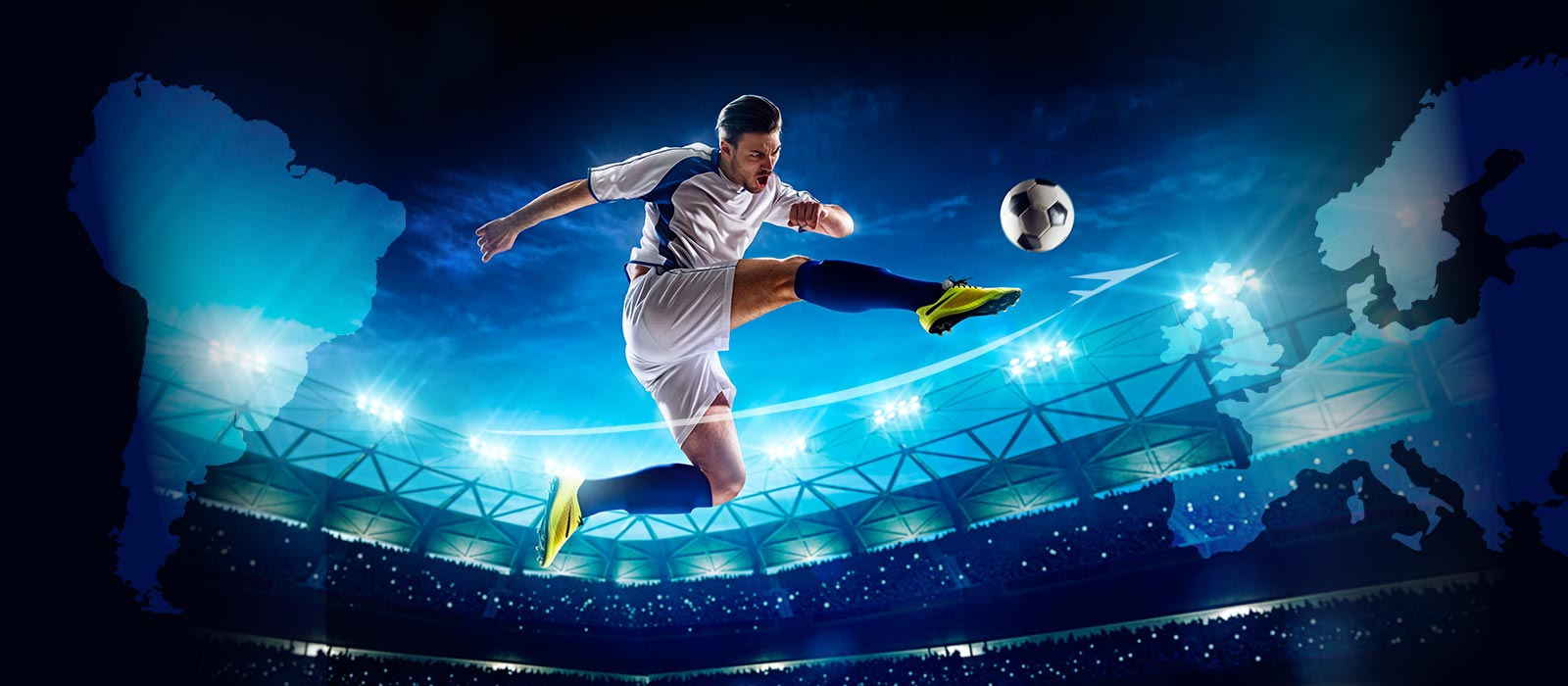 Football/soccer player jumping in front of evening sky to hit football/soccer in stadium
