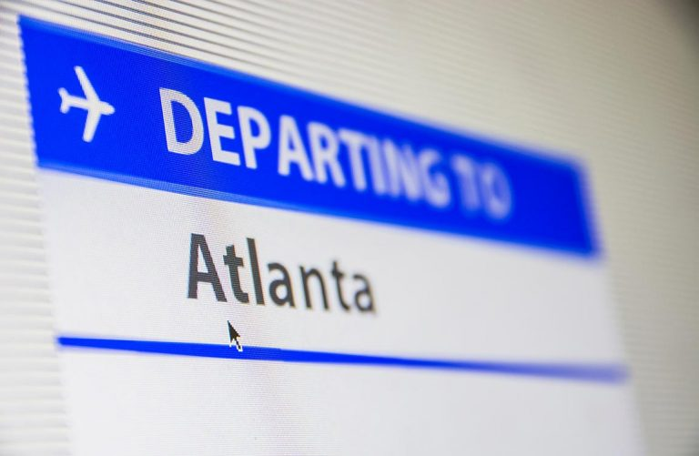 """""""Departing to Atlanta"""" text on computer screen"""