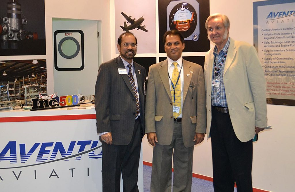 Aerospace designer Burt Rutan visits Aventure team members Zaheer Faruqi and Amyr Qureshi at the Aventure Aviation booth at the 2011 Dubai Airshow