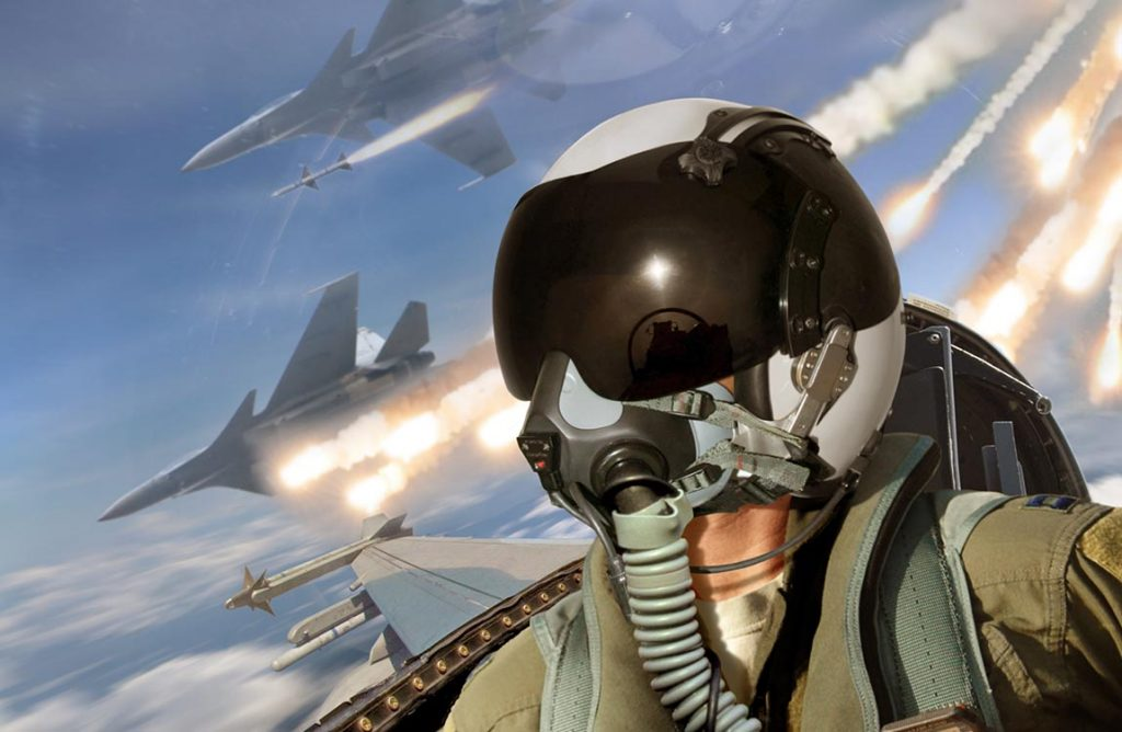 Close up of fighter pilot with two fighter jets in background firing missiles