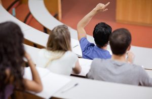 Close up of four university students in lecture hall