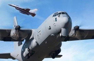 F-16 fighter jet and C-130 cargo airplane in flight