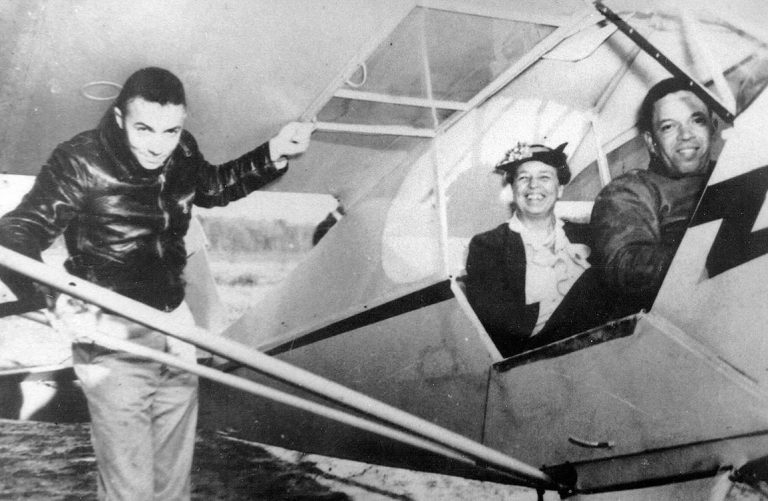 March 1941 – U.S. Army Air Corps Tuskegee Airman pilot Alfred Anderson (right) with First Lady Eleanor Roosevelt (center).