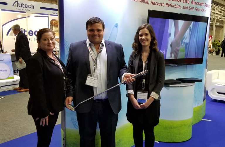 Paul White of Leki Aviation is presented with his golf club at the Aventure Aviation booth a the Dublin Aviation Summit 2017