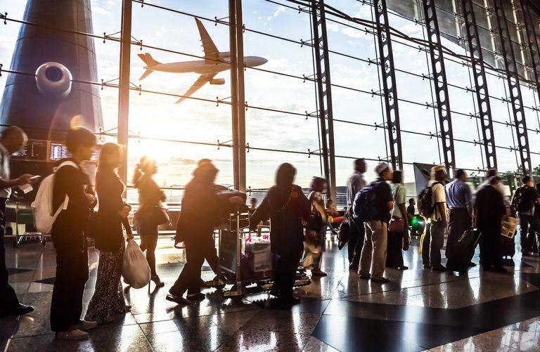 Long line of passengers inside an airport terminal